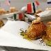 La sfogliatella entra a pieno titolo nei menù delle feste con un nuovo rustico farcita con provola, zucchine e gamberetti