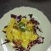 Mezze lune di patate e zucca con salsa di cipolle di Cannara, pomodori pachino, mandorle, baccalà, peperoni e aneto