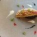 Triglia rossa in crosta di pane con fregola risottata al nero di seppia e salsa di mozzarella affumicata