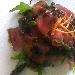 Rosa di Manzo affumicato al sapore di pistacchi scottati in aceto balsamico e con trionfo di insalata novella all'olio di frantoio
