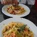 Spaghetti aglio, olio, peperoncino e mazzancolle con pane verde aromatico