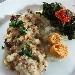 Filetto di sugherello su crema di cipolla di vatolla, mollica, mirtilli e semi di zucca con erbe selvatiche