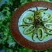 Delicatezza di calamari affumicati con mosaico di patate e peperoni