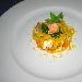 Ricetta inserita su spaghettitaliani.com da Marco Valletta: Pappardelle di grano duro allo zafferano con polpa di scampi, dadolata di pescatrice e vongole saltate con julienne di zucchine