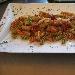 Pasta tricolore con seppie e prosciutto di Praga