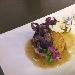 Ricetta inserita su spaghettitaliani.com da Vito Deliso: Hamburger di maialino da latte, salsa di fichi e patata viola croccante